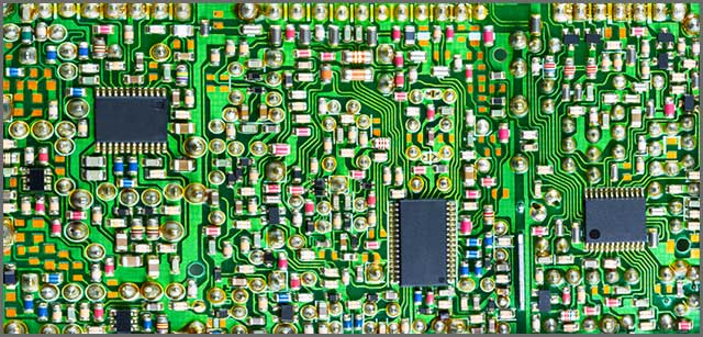 Components on a circuit board. All of these expand when their dielectric layers are heated.