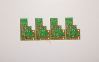 A PCB Panel with V-Grooves and four breakable boards.