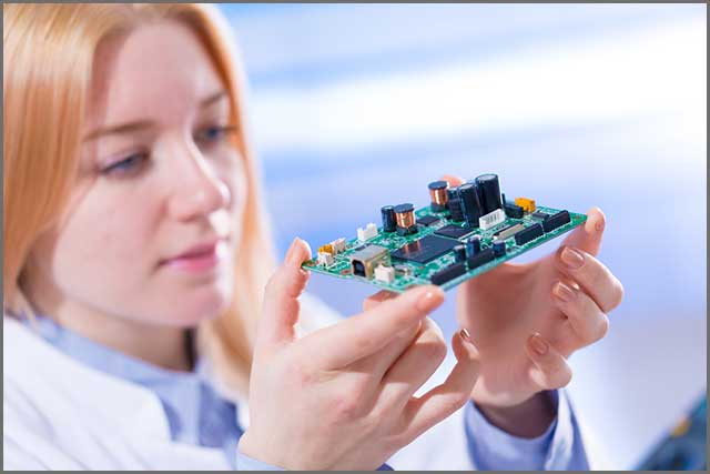 Young lady holding a printed circuit board