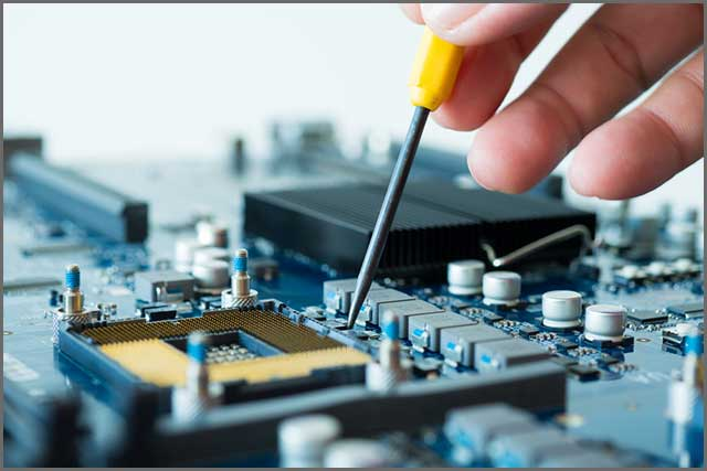An image of a technician using equipment to operate on a PCB