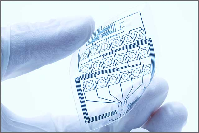 A flexible printed circuit board held by a human hand