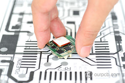 A PCB prototype as compared to the initial design