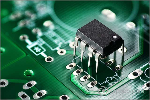 Electronic chip components on green printed circuit board