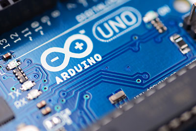 It illustrates a close-up of Arduino circuit board