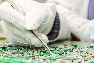 Printed circuit assembly, workers are manually assembling PCB