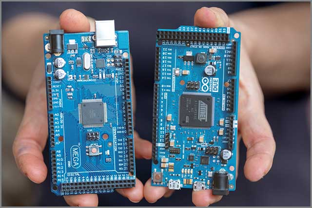 Circuit board maker showing two different models of PCB