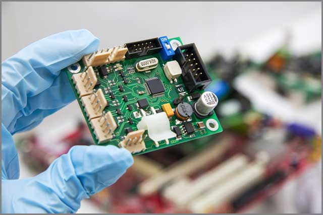 PCB chip assembly held in hand by a PCB maker online