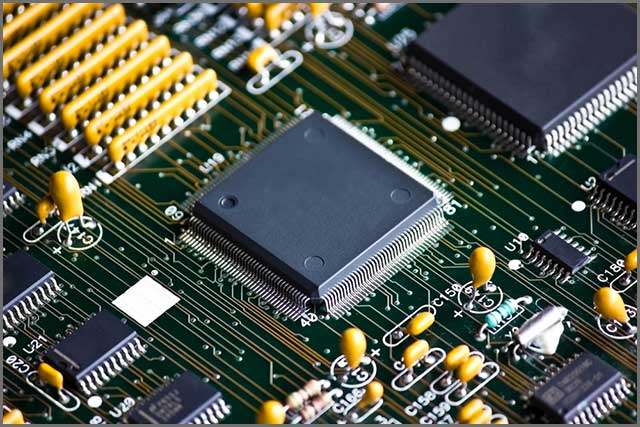 A closer picture of several components on a PCB meant for drone flight controllers