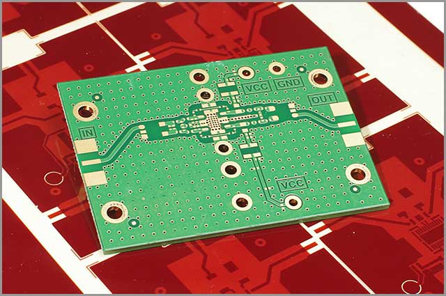A multilayered PCB on a red background