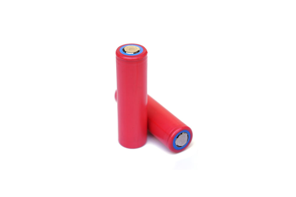 Red Lithium Ion Batteries in a white background