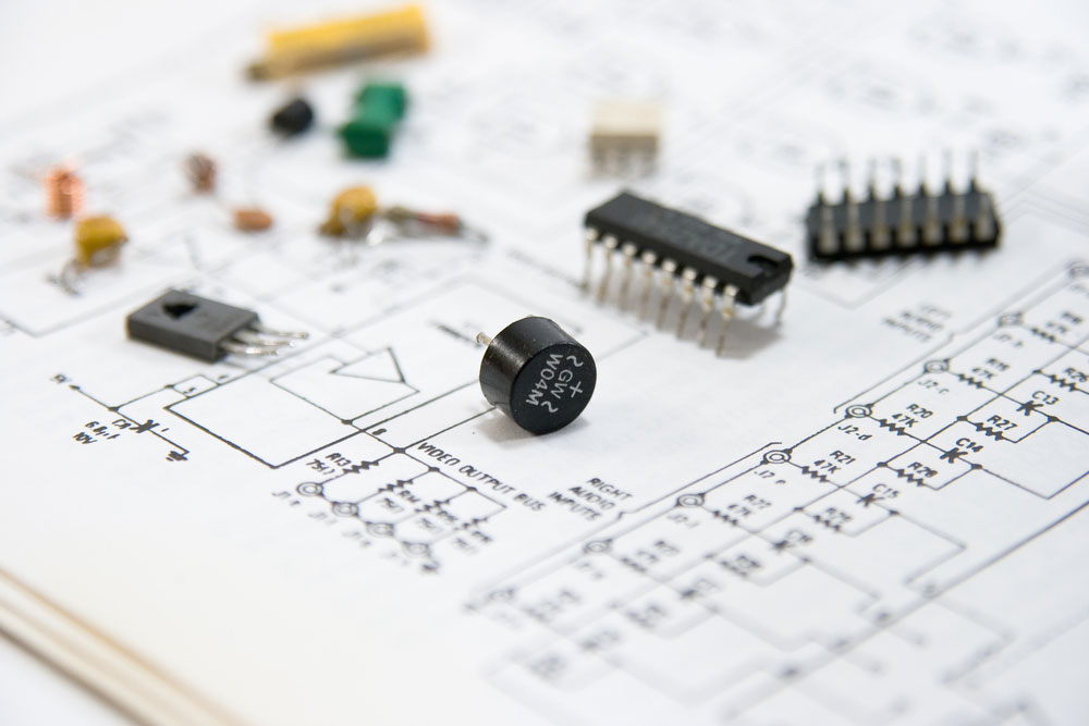 Electronic components spread out on a circuit diagram