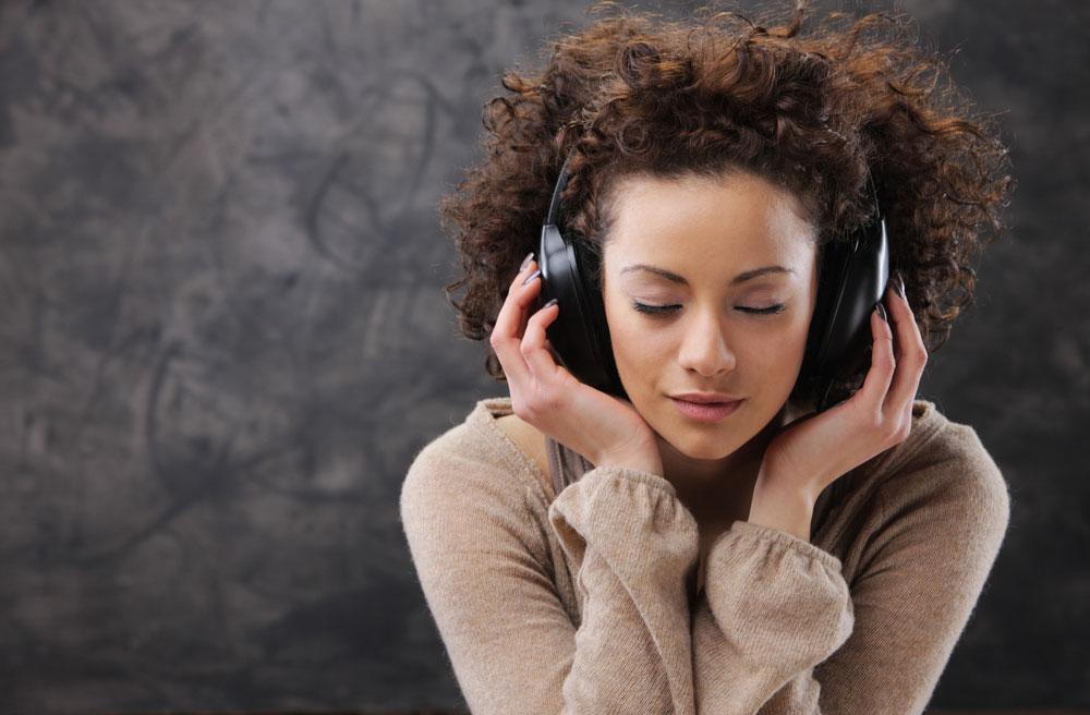 A young woman enjoying music