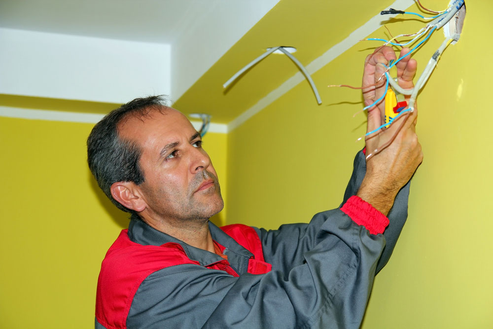 An electrician testing a connection